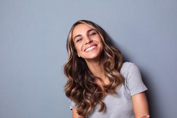 Beautiful smiling woman, studio shoot.