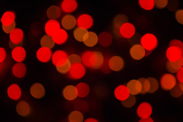 Abstract Blurry Background Bokeh. Red glitter vintage lights blurred background. Defocused, soft focus.