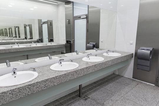 Contemporary interior of public toilet in the airport