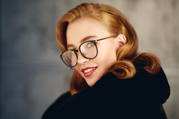 smiling girl in glasses Wall mural