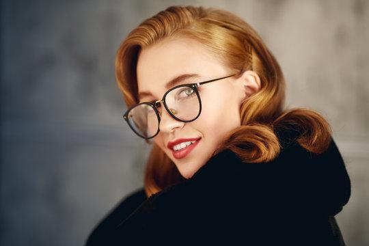 smiling girl in glasses