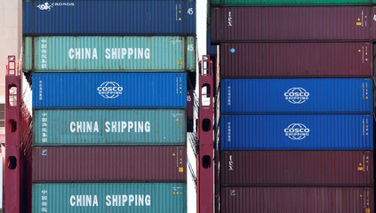 Containers of China Shipping and Cosco are loaded at a loading terminal in the port of Hamburg