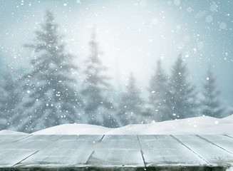 Merry christmas and happy new year greeting background with table .Winter landscape with fir tree...
