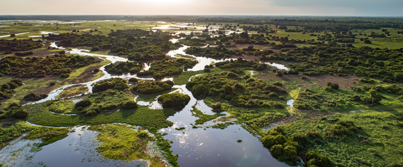 Panoramic aerial view at sunset of typical Pantanal Wetlands landscape with  lagoons, forests, meadows, river, fields, Mato Grosso, Brazil