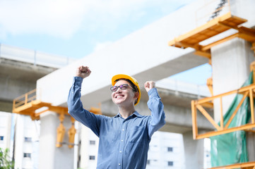 Young asian engineers are celebrate success career in the construction site background