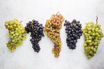 different colors, red, pink and white grapes over stone table. Top view with copy space Fototapete