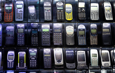 ISTANBUL, TURKEY, NOVEMBER 8, 2019: Old mobile phones on a technology market showcase. Cell phones from the early 2000's.