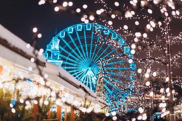 Wall Murals Kiev Christmas zone on Kontraktova Square with a Ferris wheel
