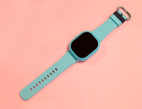 flat lay image of kids smart watch on pastel pink background