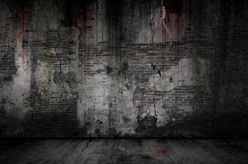 Foto op Canvas Wand Rope or noose used to hang people has stains and drops of blood are stuck with bloody background scary old bricks wall and floor, concept of murder and horror