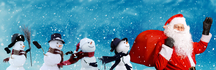 Wall Mural - Santa claus and snowmen walking through snowy landscape.Winter background .Merry Christmas and happy New Year greeting card