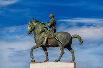 Gattamelata bronze equestrian statue among clouds, in the historic center of Padua, erected by the famous renaissance artist Donatello in 1453