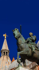 Gattamelata bronze equestrian statue in front of Basilica of Saint Anthony, in the historic center of Padua, erected by the famous renaissance artist Donatello in 1453 (with copy space above)