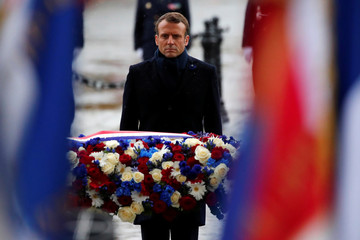 French President Emmanuel Macron lays a wreath of flowers at the Arc de Triomphe as part of commemorations marking the 101st anniversary of the