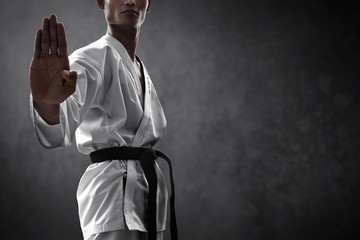 Karate martial arts fighter on dark background