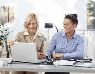 Businesswomen working at desk
