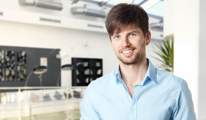 Happy young businessman in office