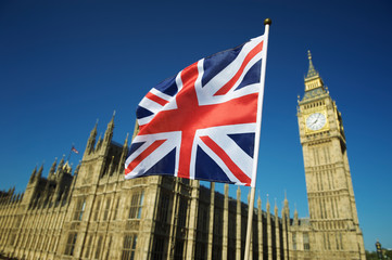 Single Union Jack flag waving in front of Big Ben at the Houses of Parliament in London, UK on a clear sunny day Fotoväggar