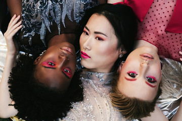 Portrait of young fashion models different races together. African, European and Chinese. Globalisation and mix race in the World concept