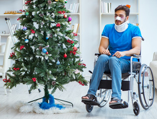Injured disabled man celebrating christmas at home