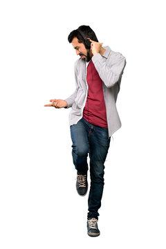 Handsome man with beard listening music