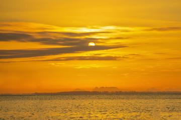Zelfklevend Fotobehang Diepbruine Golden sunrise. Early morning in the sea.