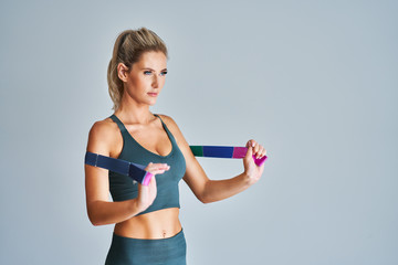 Adult woman working out with stretching belt
