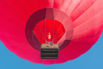 Acrylic Prints Sky sports Red hot air balloon on blue sky background.