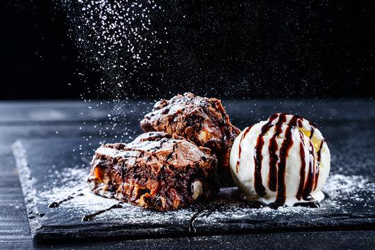 hot chocolate brownie dessert ice cream ball and slice of chocolate cake