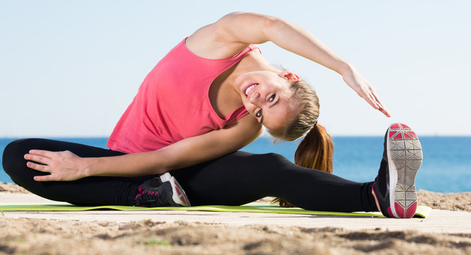 woman working out in beach