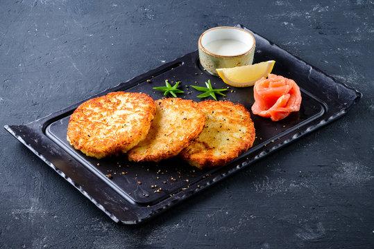 Smoked salmon and sour cream on potato latkes