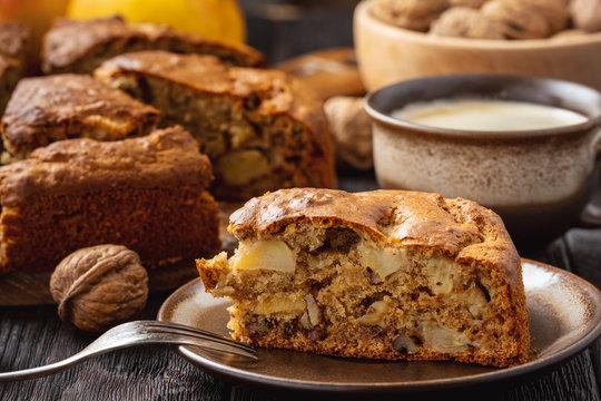 Homemade banana cake with apples and walnuts.