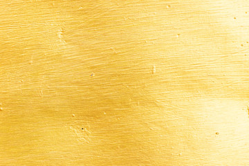 Closed up of metallic gold textured background