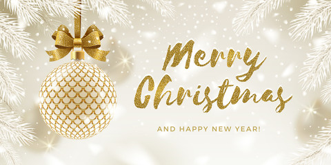 Christmas greeting card. Glitter gold brush calligraphy greeting and patterned golden bauble with bow hanging on a christmas tree. Vector illustration.