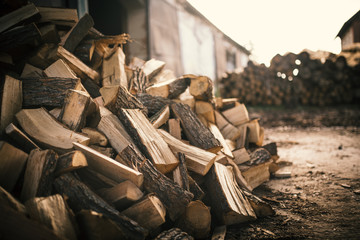 Tuinposter Brandhout textuur Pile of firewood on a heap. Coniferous and deciduous stacks of firewood.