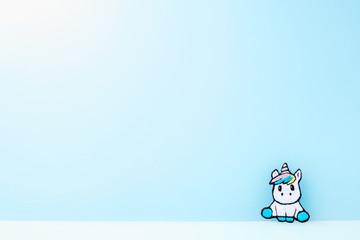 flat image of unicorn on pastel blue background