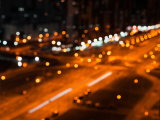Fotomurales - Blurred lights of night city and motion traffic on a highway.