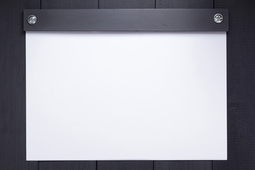 sheet of paper with empty pages on black background