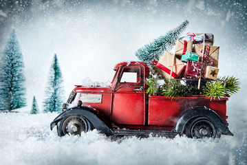 Photo sur Toile Retro Festive red vintage truck with Christmas gifts