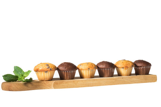Assorted fresh delicious muffins isolated on white background
