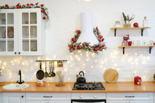 winter kitchen with red decorations, christmas cooking table and utensils