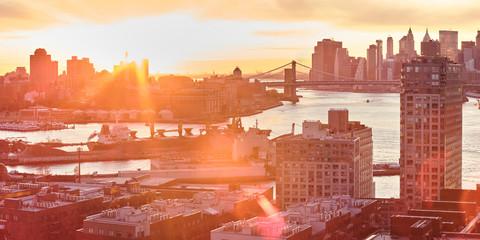 Panorama of Brooklyn and Lower Manhattan, New York City at sunset.