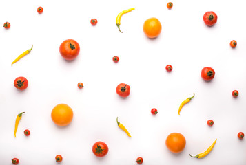 Fresh and colored vegetables background with tomatoes and chili