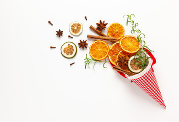 Christmas composition with dried oranges and spices on white background. Natural food ingredient...
