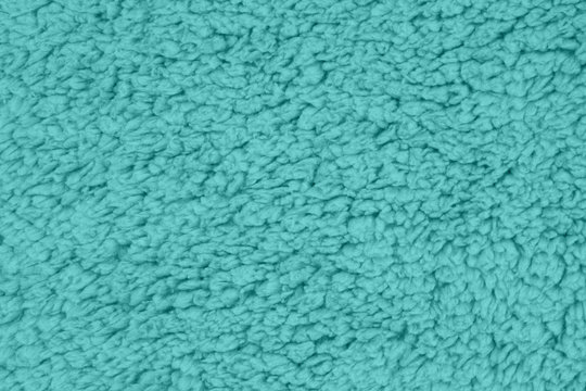 Teal sherpa textured plush fabric material background
