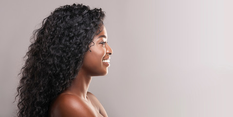 Fototapete - Smiling attractive woman with perfect skin and beautiful curly hair