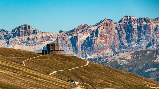 Beautiful alpine view with a well-known world war one memorial at the famous Passo Pordoi, South Tyrol, Italy