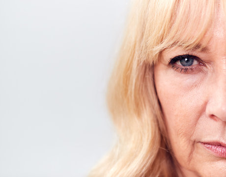 Studio Close Up Of Mature Woman Looking Suspicious And Distrustful