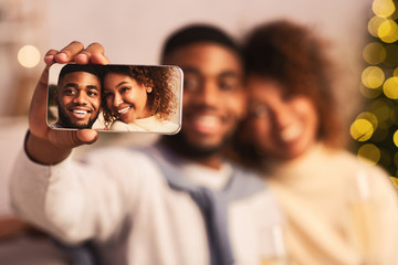Capturing bright moments. Black couple taking selfie