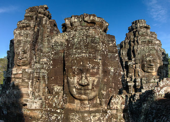 Three faces of Bayon temple at Angkor Wat